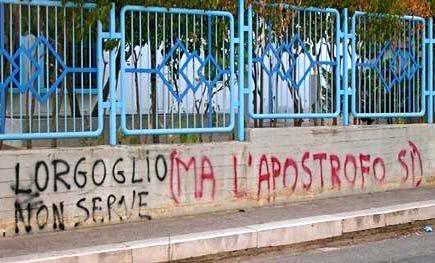 Scritta ironica su muro